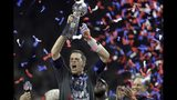 FILE - In this Feb. 5, 2017, file photo, New England Patriots' Tom Brady raises the Vince Lombardi Trophy after defeating the Atlanta Falcons in overtime at the NFL Super Bowl 51 football game, in Houston. With five rings Tom Brady has already established himself as the most-decorated quarterback in Super Bowl history. (AP Photo/Darron Cummings, File)
