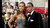 "FILE - In a Feb. 27, 2005 file photo, Sean ""P. Diddy"" Combs arrives with date, Kim Porter, for the 77th Academy Awards in Los Angeles. Coroner officials say former model and actress Kim Porter died from pneumonia. The Los Angeles coroner's office on Friday, Jan. 25, 2019 released the results of its investigation into Porter's Nov. 15 death. Investigators determined after an autopsy that her death was from natural causes. (AP Photo/Amy Sancetta, File)"