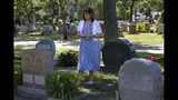 Cheryl Juaire, of Marlborough, Mass., stands at her son's grave, in Chelmsford, Mass., on Tuesday, June 19, 2018. After he died of an opioid overdose at age 23 in 2011, Cheryl slowly arrived at the sickening realization that addiction is a disease she hadn't understood, and because she hadn't understood it, she couldn't save him. She didn't even know he needed saving. (AP Photo/Steven Senne)