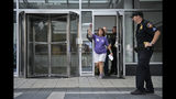 Cheryl Juaire pumps her fist in the air after delivering a letter intended for Purdue Pharma CEO Craig Landau, at the company's headquarters in Stamford, Conn., on Friday, Aug. 17, 2018. Juaire organized a protest by family and friends who have lost loved ones to OxyContin and opioid overdoses. (AP Photo/Jessica Hill)
