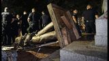 FILE - In this Aug. 20, 2018, file photo, police stand guard after the Confederate statue known as Silent Sam was toppled by protesters on campus at the University of North Carolina in Chapel Hill, N.C. The chancellor of North Carolina's flagship public university said Monday, Jan. 14, 2019, the school will remove the pedestal where the Confederate statue stood until protesters tore it down. (AP Photo/Gerry Broome, File)