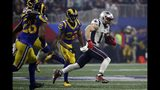 New England Patriots' Julian Edelman (11) runs the ball ahead of Los Angeles Rams' Marcus Peters (22) and Mark Barron (26), during the second half of the NFL Super Bowl 53 football game Sunday, Feb. 3, 2019, in Atlanta. (AP Photo/Matt Rourke)