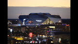 The sun sets behind Mercedes-Benz Stadium ahead of Sunday's NFL Super Bowl 53 football game between the Los Angeles Rams and New England Patriots in Atlanta, Friday, Feb. 1, 2019. (AP Photo/David Goldman)