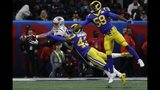 New England Patriots' Rob Gronkowski (87) stretches to catch a pass as Los Angeles Rams' Cory Littleton (58) and John Johnson III (43) defend, during the first half of the NFL Super Bowl 53 football game Sunday, Feb. 3, 2019, in Atlanta. (AP Photo/Frank Franklin II)