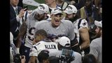New England Patriots' Rob Gronkowski (87) celebrates with teammates after the NFL Super Bowl 53 football game against the Los Angeles Rams, Sunday, Feb. 3, 2019, in Atlanta. The Patriots won 13-3. (AP Photo/Charlie Riedel)