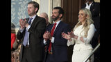 Eric Tump, left, Donald Trump Jr., center and Tiffany trump applaud as President Donald Trump delivers his State of the Union address to a joint session of Congress on Capitol Hill in Washington, Tuesday, Feb. 5, 2019. (AP Photo/Andrew Harnik)
