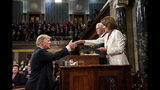 President Donald Trump shakes hands with House Speaker Nancy Pelosi as Vice President Mike Pence looks on, as he arrives in the House chamber before giving his State of the Union address to a joint session of Congress, Tuesday, Feb. 5, 2019 at the Capitol in Washington. (Doug Mills/The New York Times via AP, Pool)