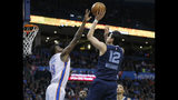 Memphis Grizzlies guard Yuta Watanabe (12 ) shoots as Oklahoma City Thunder forward Jerami Grant (9) defends during the first half of an NBA basketball game in Oklahoma City, Thursday, Feb. 7, 2019. (AP Photo/Sue Ogrocki)