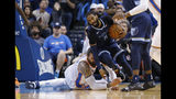 Memphis Grizzlies guard Mike Conley (11) moves around Oklahoma City Thunder center Steven Adams, left, during the first half of an NBA basketball game in Oklahoma City, Thursday, Feb. 7, 2019. (AP Photo/Sue Ogrocki)