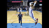 Oklahoma City Thunder guard Russell Westbrook (0) shoots in front of Memphis Grizzlies forward Justin Holiday (7) during the first half of an NBA basketball game in Oklahoma City, Thursday, Feb. 7, 2019. (AP Photo/Sue Ogrocki)