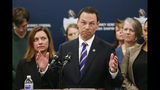 Pennsylvania Attorney General Josh Shapiro, center, speaks at a news conference about legal action in the dispute between health insurance providers UPMC and Highmark Health, Thursday, Feb. 7, 2019, in Pittsburgh. (AP Photo/Keith Srakocic)