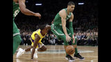 Boston Celtics forward Jayson Tatum dribbles the ball past Los Angeles Lakers guard Rajon Rondo in the first quarter of an NBA basketball game, Thursday, Feb. 7, 2019, in Boston. (AP Photo/Elise Amendola)