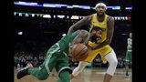 Boston Celtics guard Kyrie Irving drives against Los Angeles Lakers forward Brandon Ingram in the first quarter of an NBA basketball game, Thursday, Feb. 7, 2019, in Boston. (AP Photo/Elise Amendola)