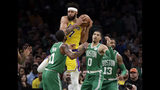 Los Angeles Lakers center JaVale McGee (7) grabs a rebound against Boston Celtics guard Kyrie Irving (11), forward Jayson Tatum (0) and forward Marcus Morris (13) in the first quarter of an NBA basketball game, Thursday, Feb. 7, 2019, in Boston. (AP Photo/Elise Amendola)