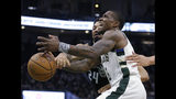 Milwaukee Bucks' Eric Bledsoe, front, loses control of the ball next to Orlando Magic's Khem Birch during the second half of an NBA basketball game Saturday, Feb. 9, 2019, in Milwaukee. (AP Photo/Aaron Gash)