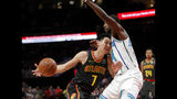 Atlanta Hawks guard Jeremy Lin (7) drives into Charlotte Hornets forward Michael Kidd-Gilchrist (14) during the first half of an NBA basketball Saturday, Feb. 9, 2019, in Atlanta. (AP Photo/John Bazemore)