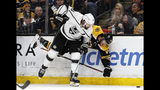 Boston Bruins' Kevan Miller is upended as he is checked into the boards by Los Angeles Kings defenseman Drew Doughty during the second period of an NHL hockey game Saturday, Feb. 9, 2019, in Boston. (AP Photo/Winslow Townson)