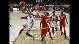 Oklahoma guard Jamal Bieniemy (24) shoots in front of Texas Tech guard Matt Mooney (13) in the first half of an NCAA college basketball game in Norman, Okla., Saturday, Feb. 9, 2019. (AP Photo/Sue Ogrocki)