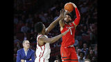 Texas Tech guard Brandone Francis (1) shoots as Oklahoma forward Kristian Doolittle, left, defends, in the first half of an NCAA college basketball game in Norman, Okla., Saturday, Feb. 9, 2019. (AP Photo/Sue Ogrocki)