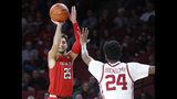Texas Tech guard Davide Moretti (25) shoots as Oklahoma guard Jamal Bieniemy (24) defends in the first half of an NCAA college basketball game in Norman, Okla., Saturday, Feb. 9, 2019. (AP Photo/Sue Ogrocki)