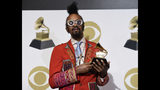"""Fantastic Negrito poses in the press room with the award for best contemporary blues album for """"Please Don't Be Dead"""" at the 61st annual Grammy Awards at the Staples Center on Sunday, Feb. 10, 2019, in Los Angeles. (Photo by Chris Pizzello/Invision/AP)"""