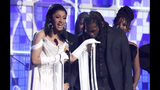 """Cardi B, left, accepts the award for best rap album for """"Invasion of Privacy"""" as Offset kisses her hand at the 61st annual Grammy Awards on Sunday, Feb. 10, 2019, in Los Angeles. (Photo by Matt Sayles/Invision/AP)"""