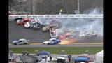 Martin Truex Jr. (19), Denny Hamlin (11), Kevin Harvick (4), Austin Dillon (3), Clint Bowyer (14), Erik Jones (20), Chase Elliott (9), Daniel Suarez (41), Ryan Newman (6), Alex Bowman (88) and Aric Almirola (10) are involved in a multi-car pileup during the NASCAR Clash auto race at Daytona International Speedway Sunday, Feb. 10, 2019, in Daytona Beach, Fla. (AP Photo/Phelan M. Ebenhack)