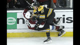 Colorado Avalanche's Matt Nieto (83) and Boston Bruins' Charlie McAvoy (73) collide sending them both to the ice during the second period of an NHL hockey game, Sunday, Feb. 10, 2019, in Boston. (AP Photo/Steven Senne)
