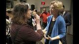 Sen. Elizabeth Warren, D-Mass., talks with a local resident during an organizing event, Sunday, Feb. 10, 2019, in Cedar Rapids, Iowa.(AP Photo/Charlie Neibergall)
