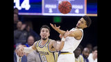 Notre Dame's Prentiss Hubb, right, recovers the ball during a steal attempt by Georgia Tech's Jose Alvarado (10) during the first half of an NCAA college basketball game Sunday, Feb. 10, 2019, in South Bend, Ind. (AP Photo/Robert Franklin)