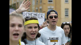 FILE - In this Aug. 23, 2018, file photo, David Hogg, 18, center right, a survivor of the school shooting at Marjory Stoneman Douglas High School, in Parkland, Fla., walks in a planned 50-mile march in Worcester, Mass. Hogg, became the most prominent spokesman for March for Our Lives, a group he and other Stoneman Douglas students founded that is pushing for stronger gun laws. (AP Photo/Steven Senne, File)