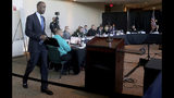 FILE - In this Nov. 15, 2018, file photo, Broward County School Superintendent Robert Runcie walks to the podium to testify during the Marjory Stoneman Douglas High School Public Safety Commission in Sunrise, Fla. The 15-member commission issued a report in January after meeting periodically for nine months to investigate the massacre's causes and examine how future school shootings can be prevented. (Mike Stocker/South Florida Sun-Sentinel via AP, Pool)