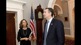 """Virginia Gov. Ralph Northam and his wife, Pamela arrive at the Governor's Mansion for an interview, Saturday, Feb. 9, 2019 in Richmond, Va. The embattled governor says he wants to spend the remaining three years of his term pursuing racial """"equity."""" Northam told The Washington Post that there is a higher reason for the """"horrific"""" reckoning over a racist photograph that appeared in his medical school yearbook. (Katherine Frey/The Washington Post via AP)"""