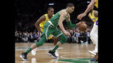 In this Feb. 7, 2019, photo, Boston Celtics forward Jayson Tatum drives against the Los Angeles Lakers during an NBA basketball game in Boston. He is wearing Nike's latest performance basketball shoes, which from concept to reality, took about three years to put together. Or 30 years, depending on how you count. The Nike Adapt BB _ a self-lacing smart shoe that can be controlled by a smartphone _ gets released to the public on Sunday, Feb. 17, 2019, a date that just happens to coincide with the NBA All-Star Game in Charlotte. It has a motor embedded within the shoe, and a hefty $350 price tag. It has a motor embedded within the shoe, and a hefty $350 price tag. (AP Photo/Elise Amendola)