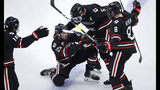 Northeastern forward Patrick Schule (25) is congratulated by teammates after his goal during the second period of the NCAA hockey Beanpot tournament championship game against Boston College in Boston, Monday, Feb. 11, 2019. (AP Photo/Charles Krupa)
