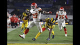 """FILE - In this Nov. 19, 2018, file photo, Kansas City Chiefs running back Kareem Hunt (27) scores a touchdown ahead of Los Angeles Rams free safety Lamarcus Joyner (20) as Chiefs offensive guard Cameron Erving (75) looks on during the first half of an NFL football game, in Los Angeles. The Cleveland Browns have signed Kareem Hunt, the running back cut by Kansas City in November after a video showed him pushing and kicking a woman the previous February. Cleveland general manager John Dorsey, who drafted Hunt while working for Kansas City, on Monday, Feb. 11, 2019, said the Browns """"fully understand and respect the complexity of questions and issues in signing a player with Kareem's history and do not condone his actions."""" (AP Photo/Marcio Jose Sanchez, File)"""