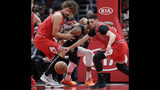Milwaukee Bucks forward Giannis Antetokounmpo, center, battles for the ball against Chicago Bulls center Robin Lopez, left, and guard Zach LaVine during the first half of an NBA basketball game Monday, Feb. 11, 2019, in Chicago. (AP Photo/Nam Y. Huh)
