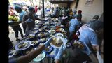 """Volunteers prepare free lunches for Venezuelan migrants at the """"Divina Providencia"""" migrant shelter in La Parada, near Cucuta, on the border with Venezuela, Colombia, Monday, Feb. 11, 2019. Millions of Venezuelans have migrated, and those left behind struggle to afford scarce supplies of food and medicine. The world watches now whether Nicolas Maduro's government will let humanitarian aid from the United States cross its borders. (AP Photo/Fernando Vergara)"""