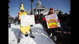 Hung Huynh, left, a teacher at Castro Elementary, joins his colleagues during a strike rally on the west steps of the state Capitol, Monday, Feb. 11, 2019, in Denver. The strike is the first for teachers in Denver since 1994 and centers on base pay. (AP Photo/David Zalubowski)