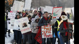 Teachers carry placards as they march along Speer Boulevard from West High School Monday, Feb. 11, 2019, in Denver. The strike is the first for teachers in Denver since 1994 and centers on base pay. (AP Photo/David Zalubowski)