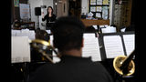 Michelle Koyama, executive principle of Skinner and Lake Middle Schools, teaches a mix of the beginner and concert bands at the school during the first day of the Denver Public Schools teachers strike, Monday, Feb. 11, 2019, in Denver. (Joe Amon/The Denver Post via AP)