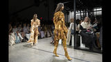 Fashion from the Zimmermann Fall 2019 show is modeled during Fashion Week, Monday, Feb. 11, 2019 in New York. (AP Photo/Mark Lennihan)