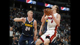 Miami Heat forward Kelly Olynyk, right, goes up for a basket as Denver Nuggets forward Mason Plumlee defends in the first half of an NBA basketball game Monday, Feb. 11, 2019, in Denver. (AP Photo/David Zalubowski)