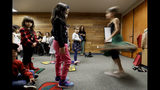In this Wednesday, Jan. 23, 2019 photo, children dance during Persian story time at Irvine public library in Irvine, Calif. It's been four decades since the Iranian revolution overthrew the ruling shah, prompting tens of thousands of Iranian exiles and refugees to make their lives in the United States. Years later, they have set down roots here and are finding ways to pass their love of Iranian culture to their American children and grandchildren. (AP Photo/Chris Carlson)