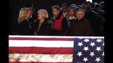 Rep. Debbie Dingell, D-Mich., left, greets the public at the casket of her husband, former Rep. John Dingell, lying in repose in Dearborn, Mich., Monday, Feb. 11, 2019. John Dingell, the longest-serving member of Congress in American history, was first elected in 1955 and retired in 2014. The Democrat was 92. (AP Photo/Paul Sancya)