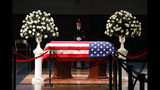 A police officer stands guard stands guard at the casket of former Michigan Rep. John Dingell, lying in repose in Dearborn, Mich., Monday, Feb. 11, 2019. Dingell, the longest-serving member of Congress in American history, was first elected in 1955 and retired in 2014. The Democrat was 92. (AP Photo/Paul Sancya)