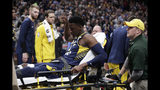 FILE - In this Jan. 23, 2019, file photo, Indiana Pacers guard Victor Oladipo is taken off the court on a stretcher after he was injured during the first half of the team's NBA basketball game against the Toronto Raptors, in Indianapolis. Oladipo's season-ending knee injury occurred in the same area that forced him to miss 11 games earlier in the season. On Monday, Feb. 11, 2019, the Indiana Pacers All-Star guard talked about the emotions he's endured since the injury, his current schedule and the possible connection between the early-season soreness and the ruptured quad tendon in his right knee.(AP Photo/Michael Conroy, File)