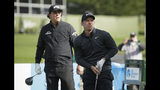 Paul Casey, right, of England, follows his drive from the third tee of the Pebble Beach Golf Links as Phil Mickelson looks on during the final round of the AT&T Pebble Beach Pro-Am golf tournament Sunday, Feb. 10, 2019, in Pebble Beach, Calif. (AP Photo/Eric Risberg)