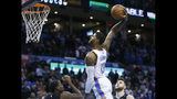 Oklahoma City Thunder forward Paul George (13) goes up for a dunk between Portland Trail Blazers forward Al-Farouq Aminu, left, and center Jusuf Nurkic, right, in the first half of an NBA basketball game in Oklahoma City, Monday, Feb. 11, 2019. (AP Photo/Sue Ogrocki)