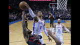 Oklahoma City Thunder guard Russell Westbrook (0) blocks a shot by Portland Trail Blazers guard Damian Lillard, left, in the first half of an NBA basketball game in Oklahoma City, Monday, Feb. 11, 2019. (AP Photo/Sue Ogrocki)